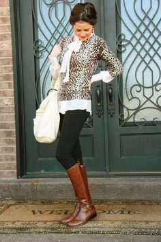 Shop this look on Lookastic:  http://lookastic.com/women/looks/knee-high-boots-skinny-jeans-tote-bag-long-sleeve-blouse-crew-neck-sweater/5102  — Brown Leather Knee High Boots  — Black Skinny Jeans  — White Leather Tote Bag  — White Long Sleeve Blouse  — Brown Leopard Crew-neck Sweater