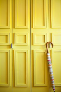 """I like finding ways to mimic the look and feel of a well-tailored home so I have also used inexpensive artist stretcher bars to feign the look of paneled molding on my generic folding closet doors.  My apartment is a rental so they are attached with removable picture hanging strips that I can take them with me when I leave.""-Janet Lee"