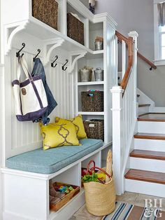 Organizing coats, shoes, and backpacks is a snap with this simple basement storage solution. Cubbies beneath a built-in bench keep shoes in order, while coats and bags hang neatly on hooks above. Simple baskets make it easy to pull out needed items while hiding any clutter. Create a similar look by installing a storage unit that blends with the color of your walls. Be sure to consider how many bags, coats, and shoes will be stored when determining what size would be best for your family.