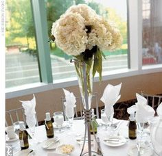 The centerpieces were trumpet-style vases that held bunches of white hydrangeas. Other centerpieces included tall vases with calla lilies and shorter cymbidium orchid arrangements.