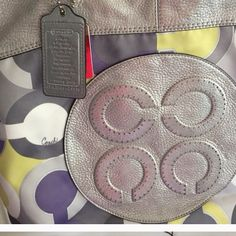 Beautiful authentic coach poppy Silver metallic and yellow white and purple for spring mint condition large bag you will love it!!! Coach Bags Shoulder Bags