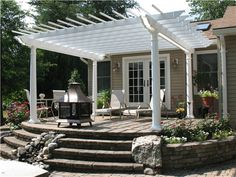 This elegant pergola would fit right into a Victorian garden theme. Add a climbing rose for an old-fashioned appeal. Designed by Continental Landscaping in Severn, MD.
