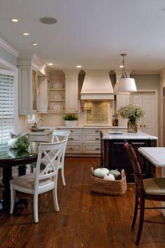 Creamy Cabinetry.  Love the tile back-splash.