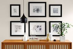 Get inspired with one-of-a-kind frame walls. From grid-style arrangements to a totally eclectic look, creating a frame wall adds personality to your space. Modern Picture Frames, Modern Pictures, Ottoman In Living Room, Dining Room, Entryway Furniture, Kitchen Furniture, Living Room Lighting, Kitchen Lighting, Architectural Elements