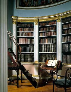 The library, Kenwood House, Hampstead, Camden, London  ©  English Heritage Photo Library Reference Number: J890378	   Caption:	A detail in the library at Kenwood House, showing several cases of leather bound volumes and other library furniture. The Jacobean house was remodelled by Robert Adam between 1764 and 1773, including the library. Photographer:	P Highnam	Date Taken:	October 1989