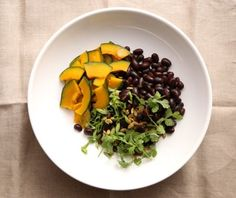 A perfect warm winter Black Bean Salad with Tangy Cilantro Pumpkin Seed Dressing.