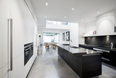 Black and white kitchen design with Terra Oak wood laminate and white matt laminate finish