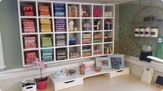 This is the mother of all fabric displays! Sew at Home Mommy built this shelving unit herself to organize her fabric, but you could mimic the look with some already made cube shelves.