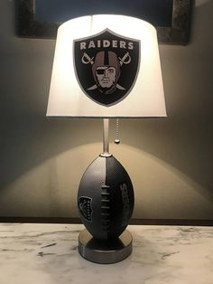 Total height of Lamp 19 inches and the size of the lampshade is 10 x 8 with a 7 inch slope nike Oakland Raiders,nike Oakland Raiders Raiders Gifts, Raiders Stuff, Oakland Raiders Merchandise, Oakland Raiders Football, Man Cave Room, Man Cave Home Bar, Oakland Raiders Man Cave Ideas, Football Rooms, Football Stuff