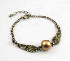 Pulseira pomo Harry Potter na cor bronze com asas ouro velho - Bijoux Anciens