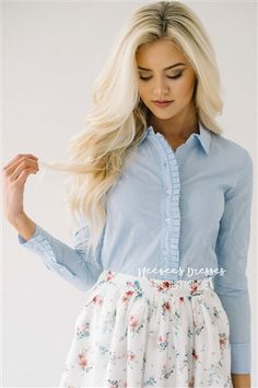 Talk about adorable, we are obsessed with this new top! Light blue and white pinstripe top features buttons up the front with a cute ruffle detail.