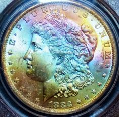 1883-O Silver Morgan Dollar - PCGS MS64+ - Rainbow Toned
