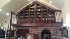 Upper library with books.  Library boxes recessed into wall.