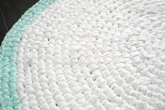 White, cotton, handmade rag rug with mint border. Washable, eco-friendly and cute in any room! #crochet