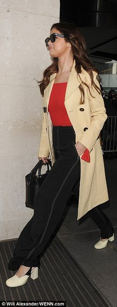 All dressed up: The 23-year-old looked super chic in a fitted long-line jacket with black ...