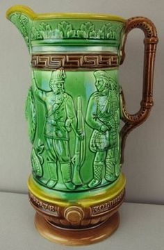 Majolica Pottery; English, Pitcher, Soldiers, Green, 11 inch.