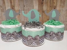 Set Of 3 Mint & Grey Baby Elephant Mini Diaper Cake Each cake is made With -10 Premium Diapers Size1 ( 8-14 lb) Cute Handcrafted Elephant High Quality Ribbons Stands approximately 8 tall and 6 wide. This adorable cake will arrive fully assembled wrapped in tulle tied with