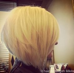 The elegant smooth and tousled layered style can charmingly contour the jaw-line showing off the jagged cut layers throughout the sides and back which enhances shape to the stacked bob haircut.