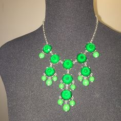 Green Bubble Statement Necjlace This necklace is silver with green bubbles. It has a lobster claw and is adjustable. This is a great pop of color against a collared shirt. New York & Company Jewelry Necklaces