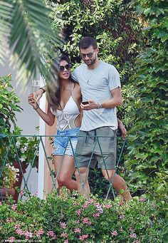 Smitten: Nicole Scherzinger, 38, looked in the throes of love as she went for a romantic lunch with beau Grigor Dimitrov, 25, in Portofino, Italy