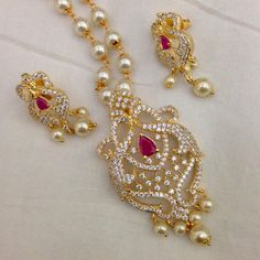 CZ and Ruby pendant with pearl drops and earrings Code : PS 399 Price: Rps. 1195/- Whatsap to 09581193795 for order processing