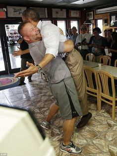 Obama hoisted off the ground in a big bear hug by a Florida pizza shop owner...