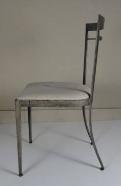 Set of Four Vintage Steel Chairs with Aged Patina | From a unique collection of antique and modern chairs at https://www.1stdibs.com/furniture/seating/chairs/