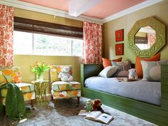 From the unexpected color scheme of celery, olive, blue-gray and tangerine, to the clever space planning, this children's room is just as appealing to parents as it is to kids.