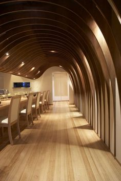 """The cave restaurant by Koichi Takada Architects uses the rhetoric of """"cellar"""" to create a warm and comforting ambiance for dining.  The wood paneling difuses sound and creates a warmth allowing for pleasant conversations and relaxed dining."""