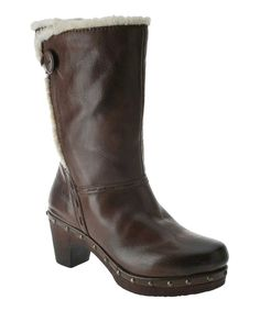 A fashionable cadence begins with these smooth leather boots. The faux fur piping and decorative studs create a boot with trendsetting appeal.2.5'' heel with 1'' platform9'' shaft12'' circumferenceZipper closureLeather upper