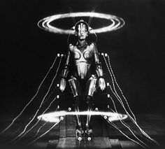 Metropolis (1927): Fritz Lang's film, set in a futuristic urban dystopia, features a female robot brought to life by a mad scientist. The styling of the robot was later to influence the look of C3PO.