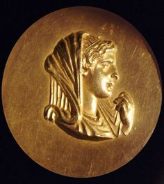Olympias, mother of Alexander the Great, on an Athletics Gold Medal, from Macedonian games at Beroea 200AD. Reverse shows a Nereid riding a sea-monster. Thessalonica Archaeological Museum