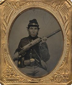 A unique and rare sixth plate tintype of a Native American serving with the United States infantry. There were approximately 20,000 Native Americans that served both north and south during the war. Fully equipped with a US waist belt. M1858 smooth side canteen, cap box and cartridge box which is worn on the belt with the bayonet housed in the scabbard. (Continued in comments.)