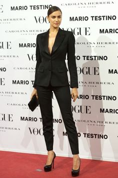 Classic black suit for the female officiant/bridesmaid? something a little sexy and unexpected...?