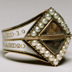 Georgian Mourning Ring of two unmarried siblings as indicated by the use of white enamel. Photo courtesy of The Walters Art Museum.