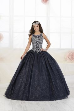 Fiesta Quinceanera 56358 Tulle ball gown featuring a fully beaded bodice, sheer neckline and back-lace up. Glitter tulle is added to the tulle skirt for a touch of Quinceanera Dresses, Quinceanera Hairstyles, Quinceanera Party, Tulle Balls, Tulle Ball Gown, Tulle Dress, Ball Gowns, Indian Wedding Hairstyles, Braided Hairstyles Updo