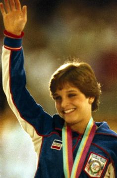 1984 Summer Olympics Closeup of USA Mary Lou Retton victorious with gold medal after winning Women's Individual All Around at Pauley Pavilion Los...