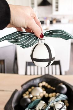 Learn how to make these easy DIY Black and White Ornaments in just a few mintues! Use these handmade ornaments for your tree or Christmas decorations. White Ornaments, Glitter Ornaments, Handmade Ornaments, Beaded Ornaments, Handmade Art, Felt Christmas Decorations, Diy Christmas Ornaments, Homemade Christmas, Wood Bead Garland