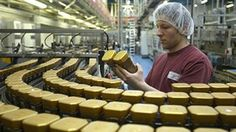 A staff performs a visual check on packages in the Nescafe production facility in Orbe March 25 2013