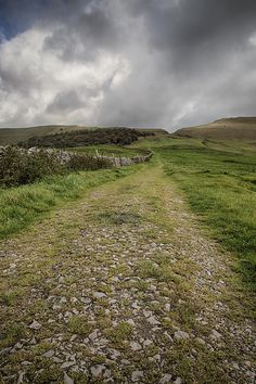 Title  High Peak Trail  Artist  Nigel Jones  Medium  Photograph - Photography  Description  An old pack horse trail in the High Peak area of the Peak District National Park. The trail leads to the gap or notch in the hills beyond which is Edale and the Hope Valley.