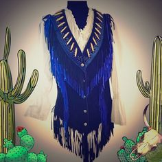 Tribe America Blue Leather Beaded Vest w/ Fringe! This is an awesome vest, originally retailing for $350. It is in excellent condition with rich blue leather and satiny lining. The Leather is extra soft. Great for a night out with jeans or a skirt. Vintage boho cowgirl. Bring the old wast back.Tribe America Leathers takes great pride in making all of our garments in the USA. Each item is an original piece and it is all handmade.  Sorry it doesn't come with the white shirt.  Tribe America…