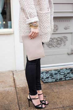 Winter neutrals - cosy bulky sweater jacket with black pants and sandals styled and worn by A Piece Of Toast - Love the bracelets!
