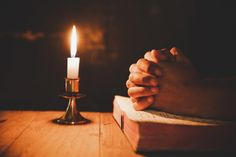 Man praying on the bible in the light candles selective focus Photo Praying Hands Drawing, Bible Photos, Man Praying, La Sainte Bible, Wedding Unity Candles, Candle Labels, Label Templates, Candle Set, Banners