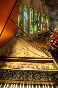 Harpsichord and beautiful stainglass windows...
