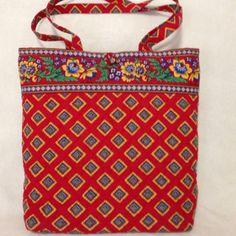 """Vera Bradley Tote in Villa Red pattern. Never used, In pristine condition, no stains tears, rips or fading. Dimensions: 13""""X12""""X4"""", Strap drop: 13"""". Interior had one large slip pocket. Button closure on top of bag. The Villa Red pattern retired in July 2005. Comes from a smoke free home. (Price includes shipping)"""
