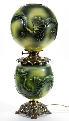"PITTSBURGH ""DRAGON"" PARLOR / GONE WITH THE WIND LAMP, opaque white with green and yellow shading, matching pattern ball-form shade, urn-form base, cast metal crown ring with leaf ornamentation, cast-iron foot with scroll openwork, brass drop-in font with side-refill feature and unpatterned shoulder."