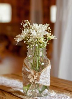 lace, burlap and country styled weddings! Mason jar centerpieces with lace and burlap, daisies and baby's breath flowers. Lace and burlap runners on picnic style tables. Wedding reception decor for a country wedding Wedding Reception Flowers, Wedding Reception Decorations, Wedding Centerpieces, Wedding Table, Diy Wedding, Rustic Wedding, Wedding Day, Trendy Wedding, Wedding Beach