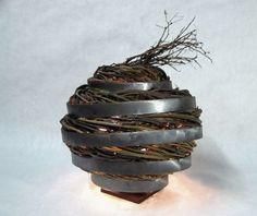 eco-art meets home decor: reclaimed steel + sticks sculptural lamp