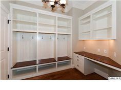 Like the dark wood/white combo and the work surface. Don't need desk drawers--need lower cabinets.