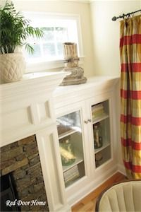 Love the glass shelving unit on both sides of the fireplace.. Beautiful